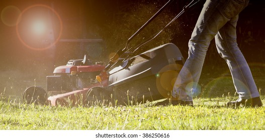 Man mowing the lawn  in summertime