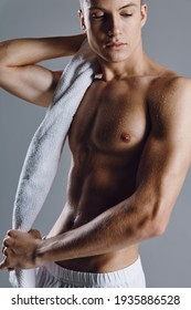 man with muscular body close-up workout towel