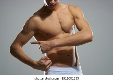 Man with muscular torso inflated exercise workout muscle health
