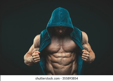 Man with muscular torso. Strong Athletic Man Fitness Model Torso showing six pack abs