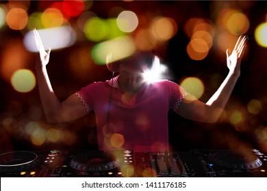 Man Music Dj dancing in nightclub  and light bokeh