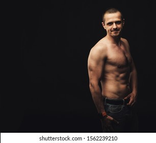 Man with naked natural athletic body looking in camera