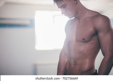 man with a naked, wet, athletic body
