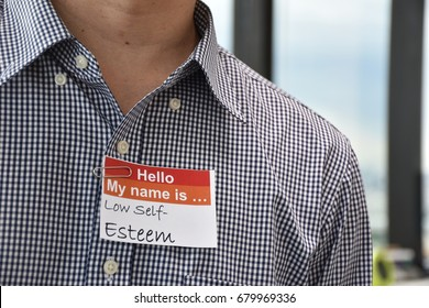 A man with a name tag indicating his low self esteem character
