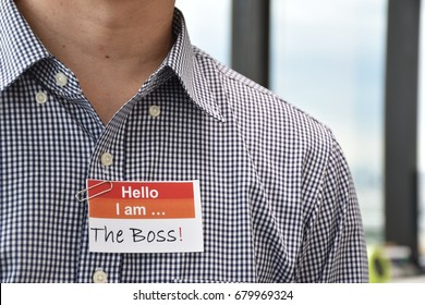 A man with a name tag indicating the role he plays used to illustrate management concept