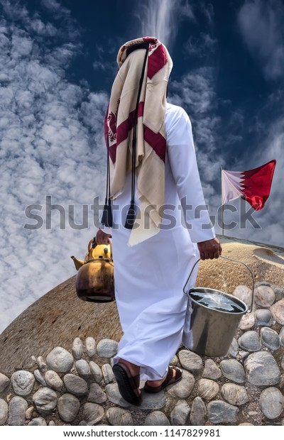Man in national Qatar clothes carries a bucket full of water to the mountain with the Qatar flag. Collage.