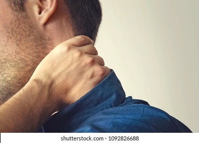 Man with neck pain. young guy holding his neck. a sore neck. chondrosis. the concept of health. fracture of the cervical spine. copy space. copyspace.