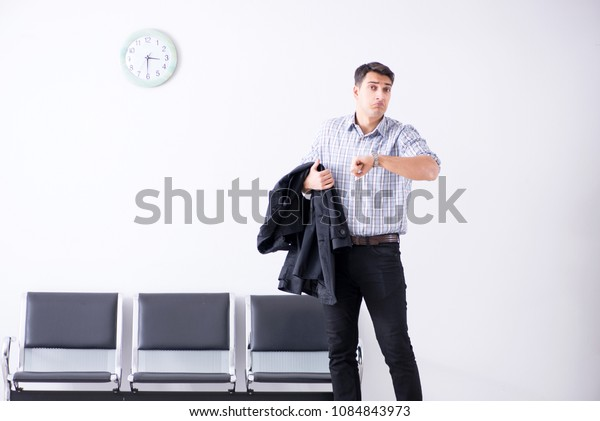 Man nervously impatiently waiting in the lobby