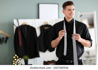 Man in new outfit indoors. Fashionable wardrobe