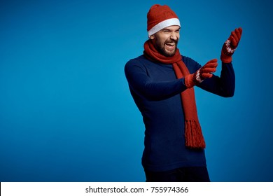 man in a New Year's cap in a scarf, on his hands gloves, cold, warm, December, January, holiday, Christmas