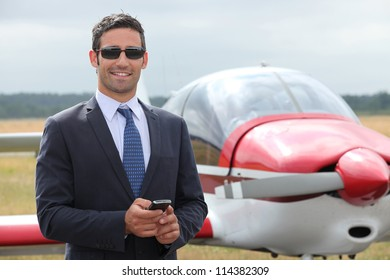 Man next to a light aircraft