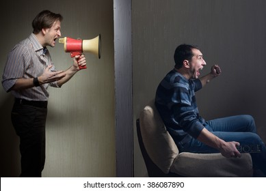 Man at night yells through a megaphone at the noisy neighbor