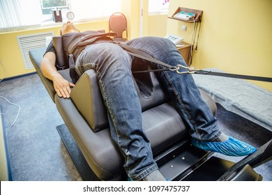 Man at non-surgical spinal decompression procedure in medical center