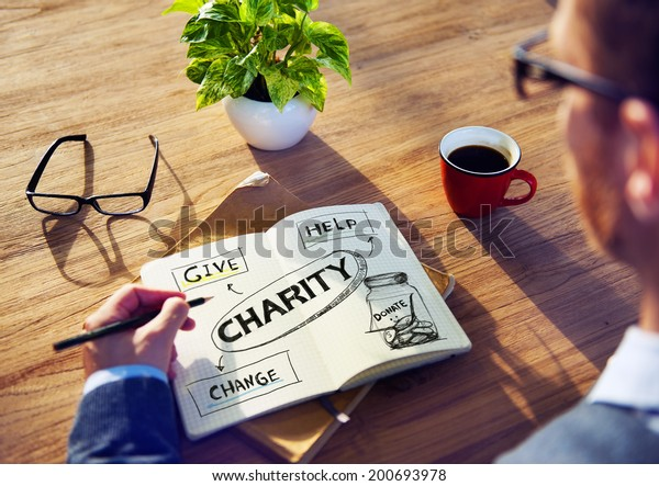 Man with Note Pad and Charity Concepts