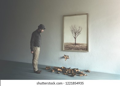 man observing leaf falling from painting