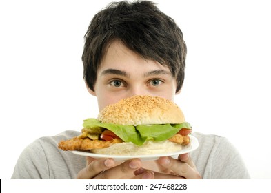 Man offering a big hamburger, fast food, take out for you