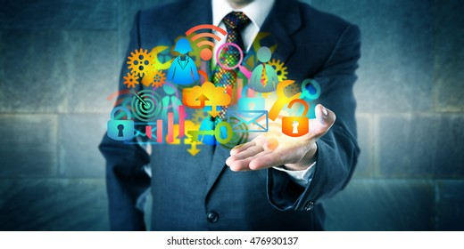 Man offering a cloud infrastructure solution made of a host of colorful managed services icons. Information technology concept for desktop virtualization, digital transition and MSP as facilitator.