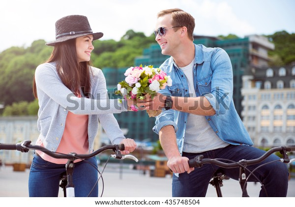 : Man offering flowers to woman