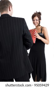 Man offering a gift to a woman