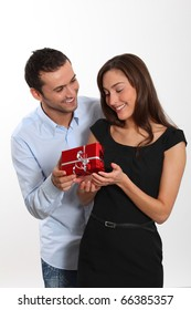 Man offering present to girlfriend