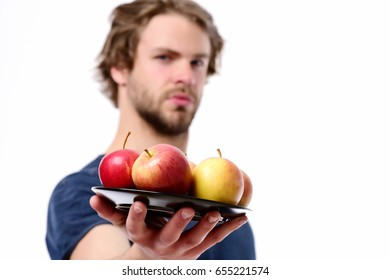 Man offers apples.