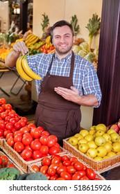 Man offers fresh bananas.