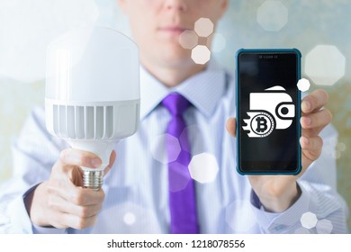Man offers a led bulb and smartphone with wallet bitcoin. Cryptocurrency Blockchain Mobile Online App Banking Payment concept.