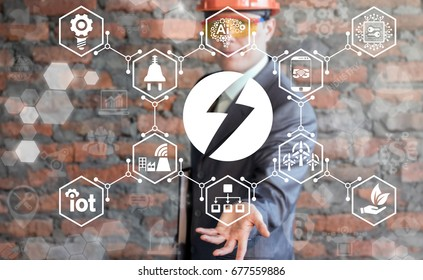 Man offers lightning icon on virtual screen. Flash Power Energy Electricity Production concept. Electrical Industry 4.0 IT Manufacturing Innovative Technology. Dangers manufacture.