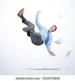 Man in office clothes falls down with sheets of paper on light background. Falling markets and bankruptcy concept