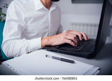 Man in the office with  hands on the keyboard