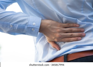 Man in office uniform having back pain issue / back injury