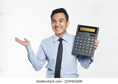 Man in office wear holding a big calculator
