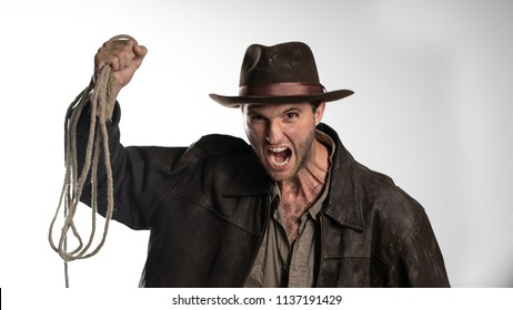 a man in an old hat screams and shows aggression.
