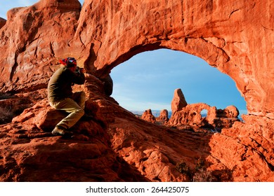 Man on Arches at dawn Utah