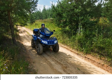 The man on atv is riding off road.
