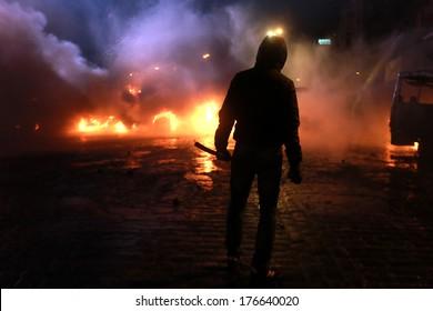 The man on the background of burning police buses. Kyiv, Ukraine, January 19, 2014