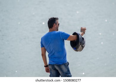 man on the background of the lake takes a selfie
