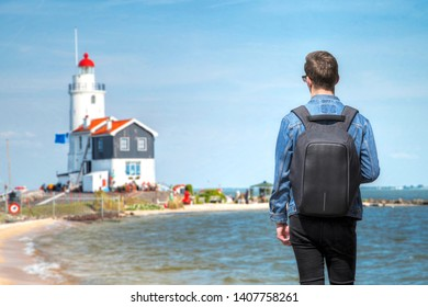The man on the background of the Lighthouse in the Dutch old village in Volendam.