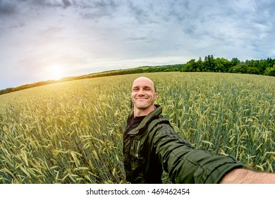 Man on the background of a wheat field. Toning
