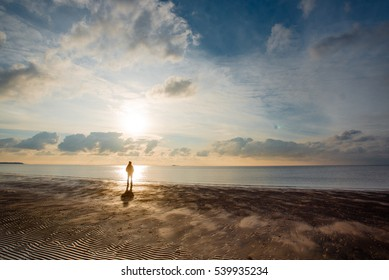 man on the beach in the evening
