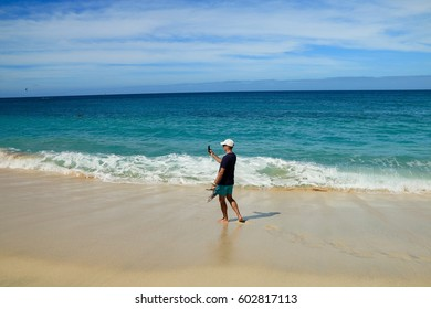 MAN ON THE BEACH SANTA MARIA, SAL ISLAND, CAPE VERDE
