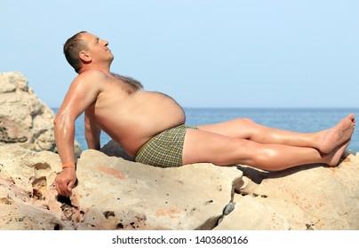 man on the beach in summer
