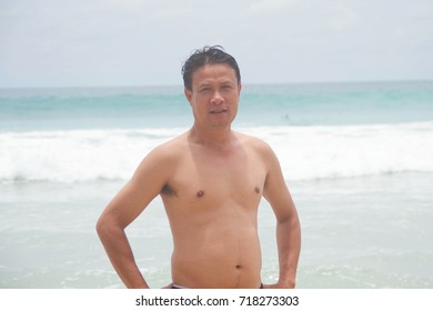 Man on the beach summer joy happy travel relax and play wave sea