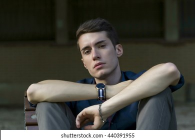 man on bench with sport whatch