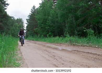 The man on a bicycle. Tourist base in the forest. Ulyanovsk Region, Russia.