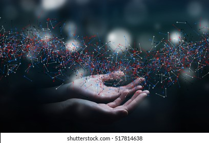 Man on blurred background holding DNA structure in his hand