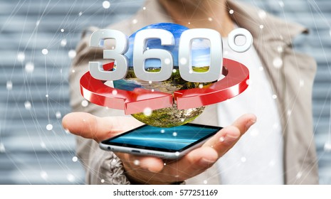 Man on blurred background holding 360 degree 3D render icon over mobile phone