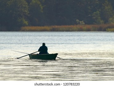 man on boat fishing