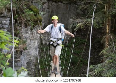 Man on bridge at via Ferrata de Tiere (Champery, Switzerland)