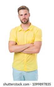 Man on calm face posing confidently with folded arms, white background. Man looks attractive in casual yellow linen shirt. Guy with bristle wears casual or formal shirt. Fashion concept.